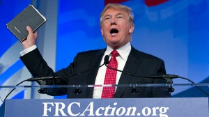 Republican presidential candidate, businessman Donald Trump, holds up his bible who was giving to him by his mother as he speaks during the Values Voter Summit, held by the Family Research Council Action, Friday, Sept. 25, 2015, in Washington ( AP Photo/Jose Luis Magana)